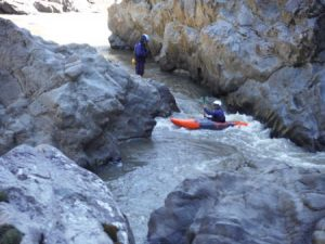 A Kayak negotiates its way around the back of the A frame rocks on the Snowy River kayak adventure