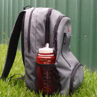 small bag for travelling on bus with water bottle in side pocket
