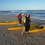 A lady with a kayak skirt on looks into the camera before departing on Kayak Port Stephens Broughton Island Tour